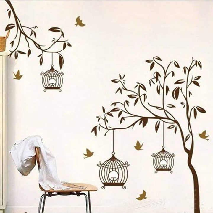 brown tree with bird cage